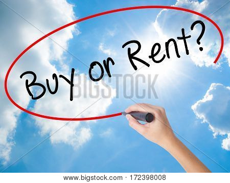 Woman Hand Writing Buy Or Rent? With Black Marker On Visual Screen