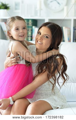 Portrait of a beautiful mother with daughter, close up