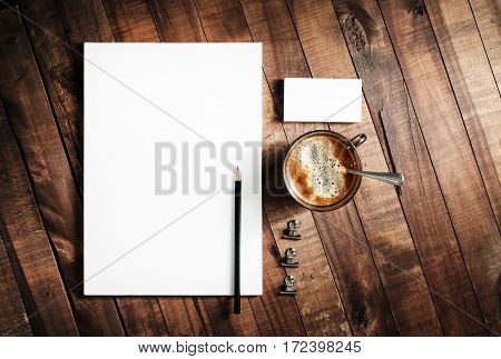 Photo of blank stationery on wooden table background. Responsive design mock up. Blank objects for placing your design. Top view.