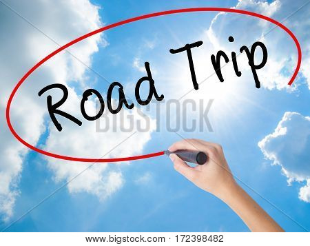Woman Hand Writing Road Trip With Black Marker On Visual Screen
