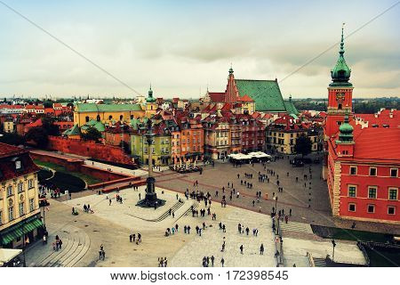 Warsaw Poland -October 09,2016 People walk on Castle Square in Warsaw in Old Town on a background of the Column of King Zygmunt III Waza & ancient townhouses. European countries. Historical landmarks.