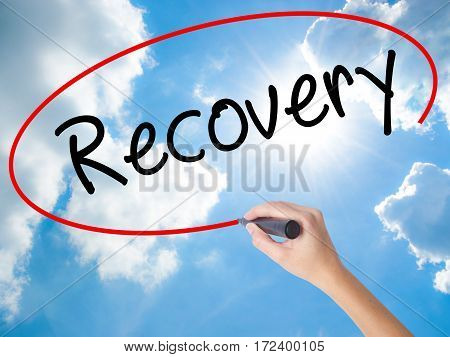 Woman Hand Writing  Recovery  With Black Marker On Visual Screen