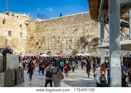 JERUSALEM ISRAEL - DECEMBER 8: The Western Wall people in the square near the Western Wall on the Temple Mount in the Old City of Jerusalem Israel on December 8 2016