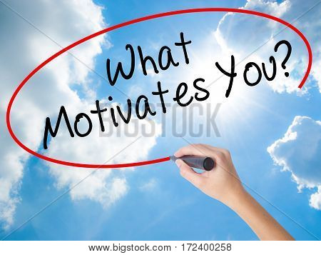 Woman Hand Writing What Motivates You? With Black Marker On Visual Screen