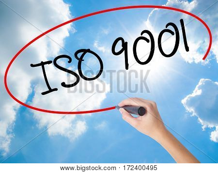 Woman Hand Writing  Iso 9001 With Black Marker On Visual Screen