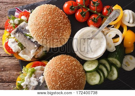 Sandwich With Marinated Herring, Gravy And Fresh Vegetables Close-up. Horizontal Top View