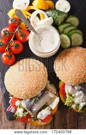 Sandwich With Marinated Herring, Gravy And Fresh Vegetables Close-up. Vertical Top View