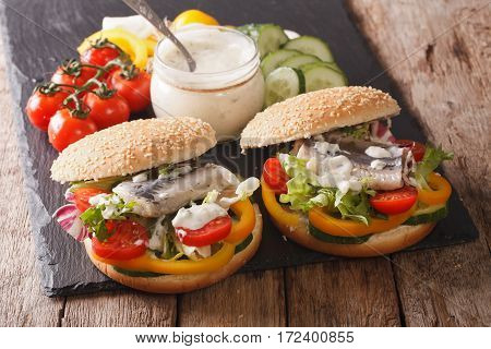 Sandwich With Marinated Herring, Gravy And Fresh Vegetables Close-up. Horizontal