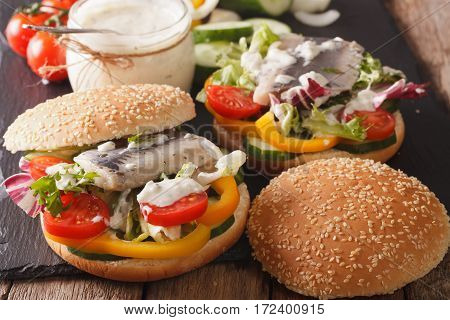 Fishburger With Herring, Gravy And Fresh Vegetables Close-up. Horizontal