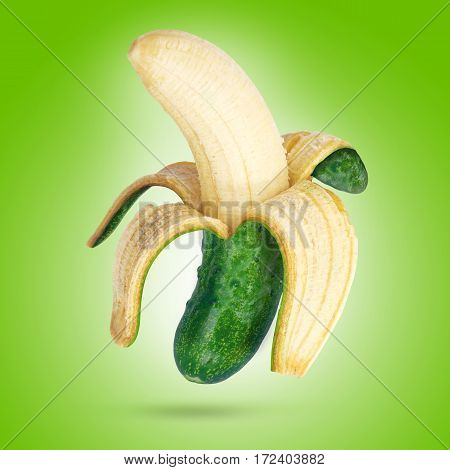 Banana and cucumber with green background .