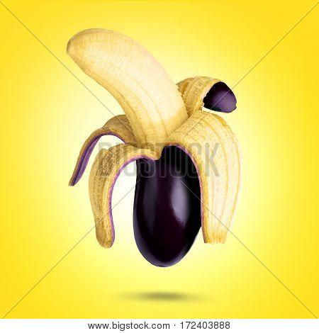 Banana and aubergine with yellow background .