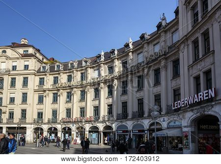 MUNICH, GERMANY - OCTOBER 31, 2015: Karlsplatz in Munich with view to the curved building towards the inner city unidentified people are walking along