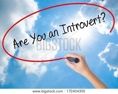 Woman Hand Writing Are You An Introvert? With Black Marker On Visual Screen