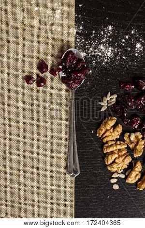 spoon with berries and walnuts in a geometric order