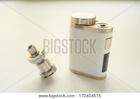 Electronic Cigarette And Liquid Tank On The Table. Vaping. Ends.
