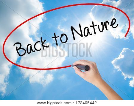 Woman Hand Writing Back To Nature With Black Marker On Visual Screen