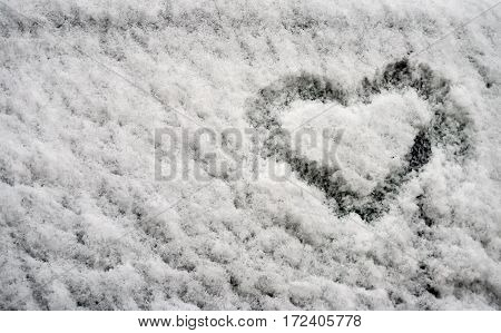 Painted in a fluffy snow heart as a symbol of the end of winter and cold like a promise of summer and love.