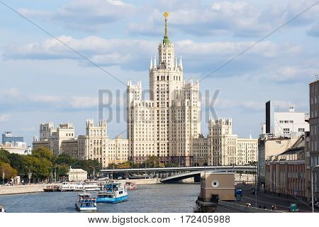 MOSCOW, RUSSIA-August 2014.View of the high-rise building in downtown Moscow.Pleasure boats on the river.
