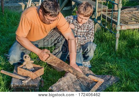 Father and son working with tools outdoor