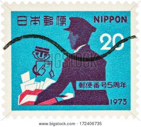 MOSCOW RUSSIA - February 20 2017: A stamp printed in Japan shows Postman with letters and post symbol series