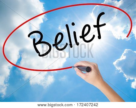 Woman Hand Writing Belief With Black Marker On Visual Screen