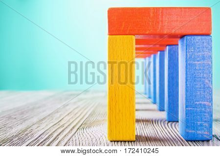 Сolorful wooden corridor with copy space. Concept of success. Abstract multicolored wooden tunnel.