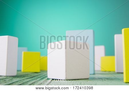 Geometric shapes on a wooden background. Colorful wooden blocks. Business concept creative thinking. Geometric shapes in different colors. Concept of creative logical thinking or problem solving.
