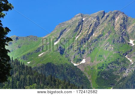 the mountains around lake Ritsa hot July