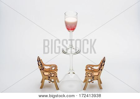 Alcohol Coctail Singapore Sling On Wineglass With Chairs