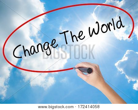 Woman Hand Writing Change The World With Black Marker On Visual Screen