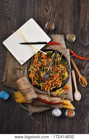 Open Notebook With Pen And Pasta