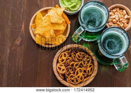 St Patrick day party - green beer and appetizers, copy space
