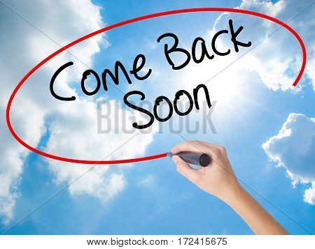 Woman Hand Writing Come Back Soon With Black Marker On Visual Screen.