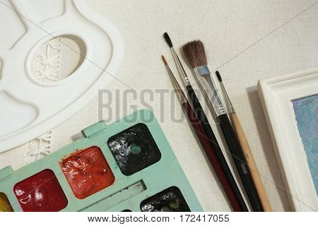 paint on canvas and brush tools artist