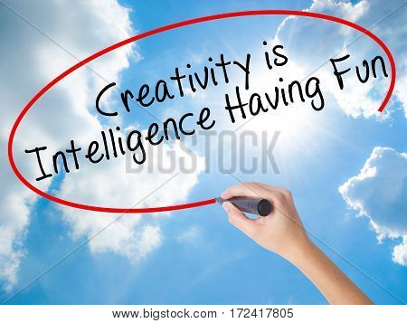 Woman Hand Writing Creativity Is Intelligence Having Fun With Black Marker On Visual Screen