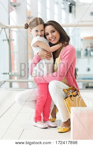 Mother and daughter hugging