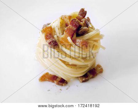 Spaghetti carborara. Ingredients: pasta eggs bacon pecorino cheese salt and pepper. Ready meal white background.