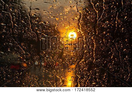 rain and sunset outside the window, unfocused background