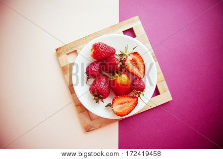 strawberry season: fresh red berries on plate