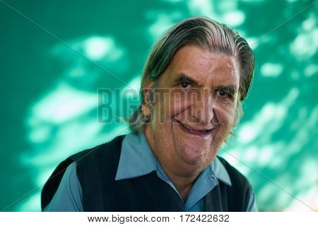 Old hispanic real people from Cuba with feelings and emotions portrait of funny senior caucasian man smiling laughing and looking at camera. Elderly white man