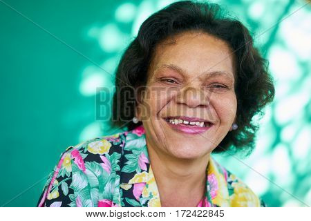 Old hispanic real people from Cuba with feelings and emotions portrait of funny senior african american lady laughing and looking at camera. Elderly black woman smiling
