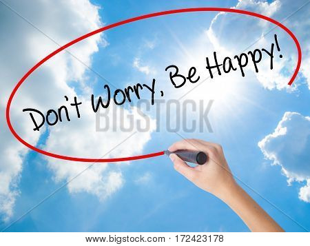 Woman Hand Writing Don't Worry, Be Happy! With Black Marker On Visual Screen