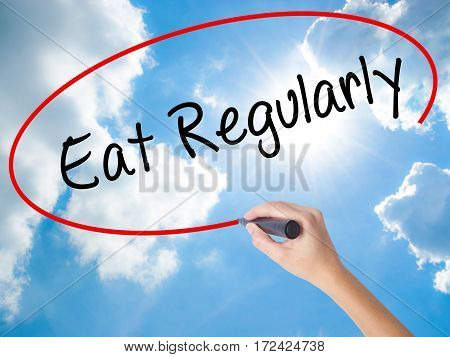 Woman Hand Writing Eat Regularly With Black Marker On Visual Screen.