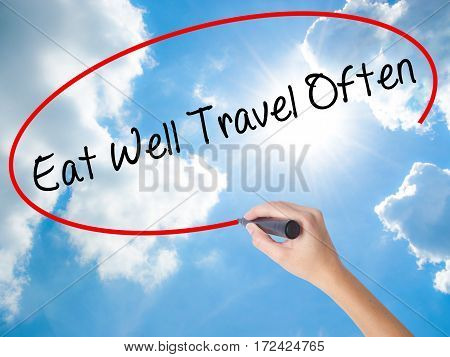Woman Hand Writing Eat Well Travel Often With Black Marker On Visual Screen