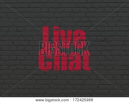 Web development concept: Painted red text Live Chat on Black Brick wall background