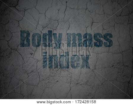 Health concept: Blue Body Mass Index on grunge textured concrete wall background