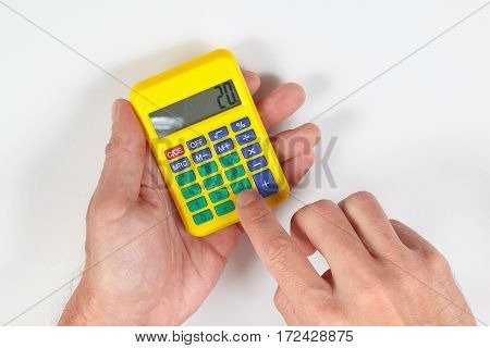 Hands calculate using a calculator on a white background