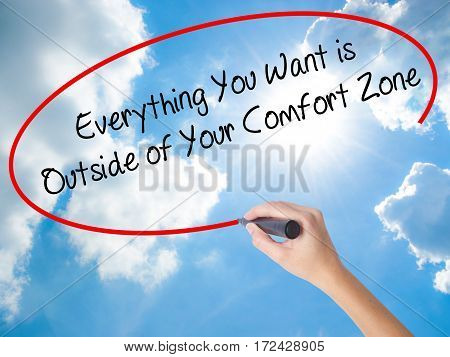 Woman Hand Writing Everything You Want Is Outside Of Your Comfort Zone With Black Marker On Visual S