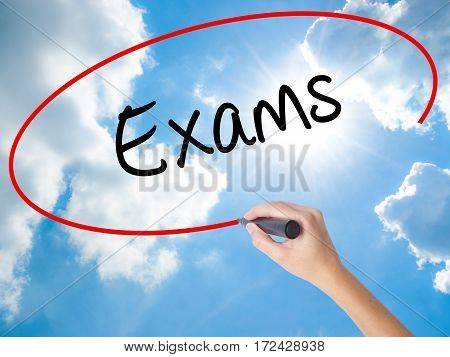 Woman Hand Writing Exams With Black Marker On Visual Screen