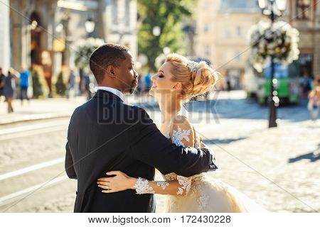 Happy African American Groom And Cute Bride Dancing On Street